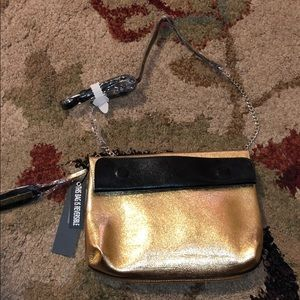 Reversible clutch with strap